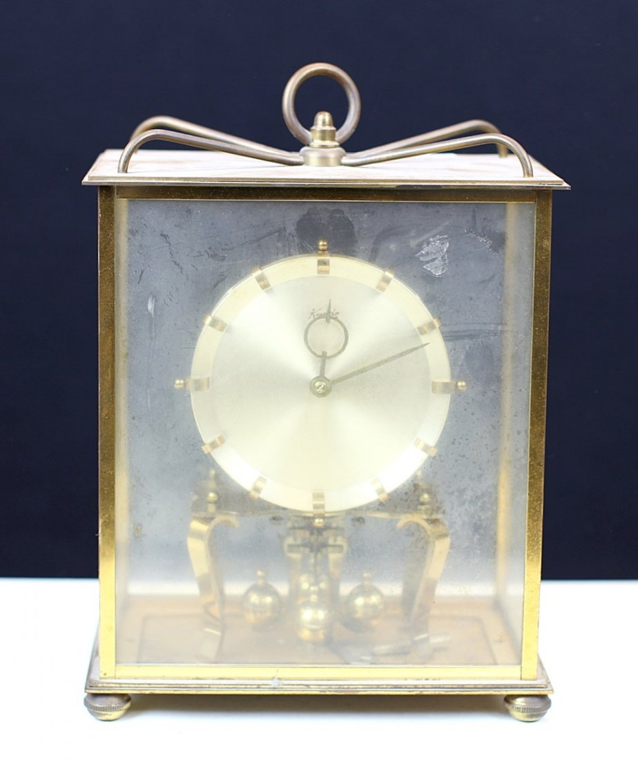 CLOCK WITH IN GLASS BOX