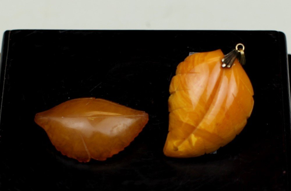 TWO VINTAGE BALTIC AMBER PENDANTS