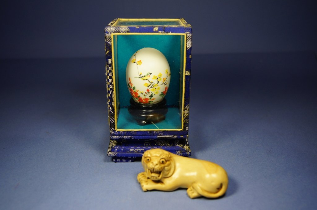 11: Chinese antique egg art and wooden lion