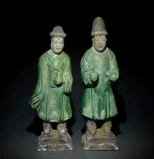 A Pair of Ming Dynasty Sancai Pottery Statues