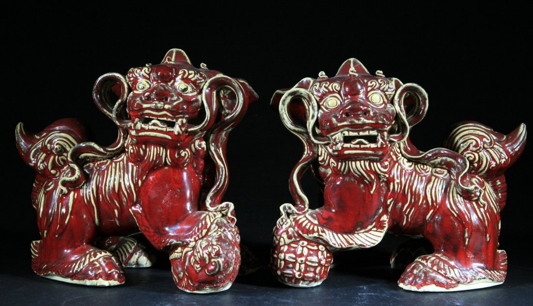 Pair of Antique Chinese Red Glazed Fu Lions