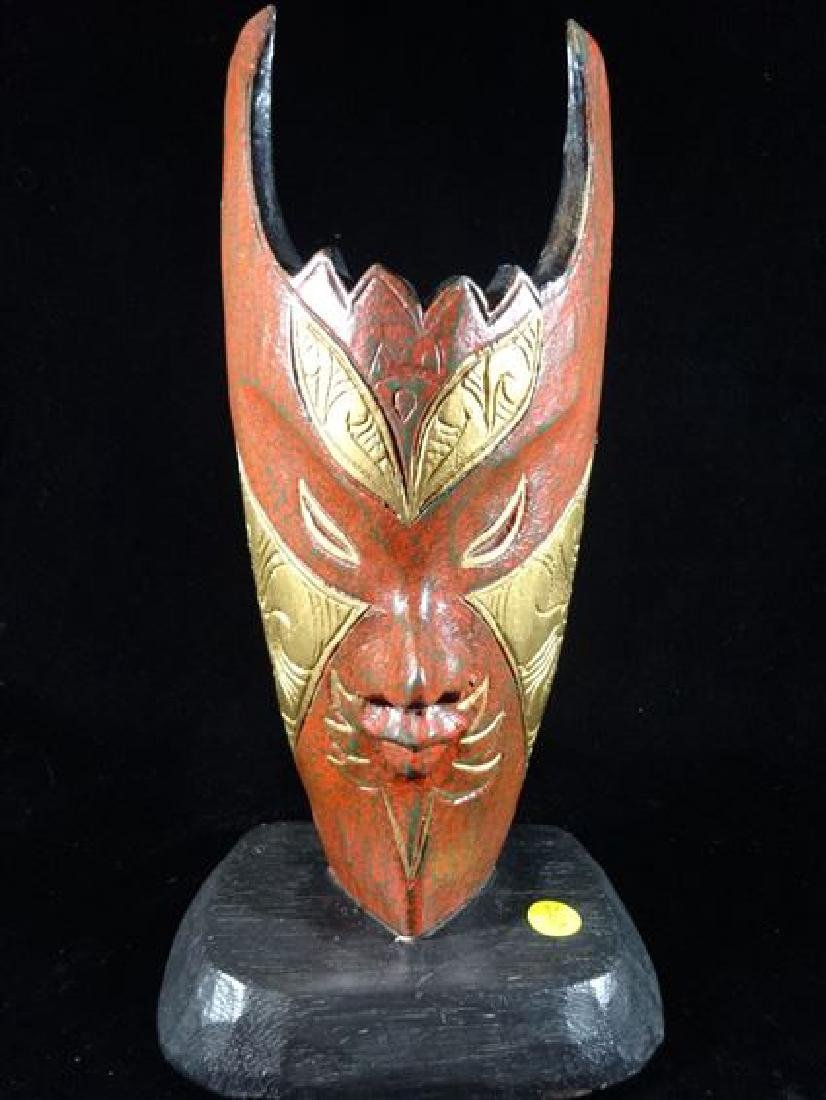 CARVED AND PAINTED WOOD MASK SCULPTURE WITH GILT