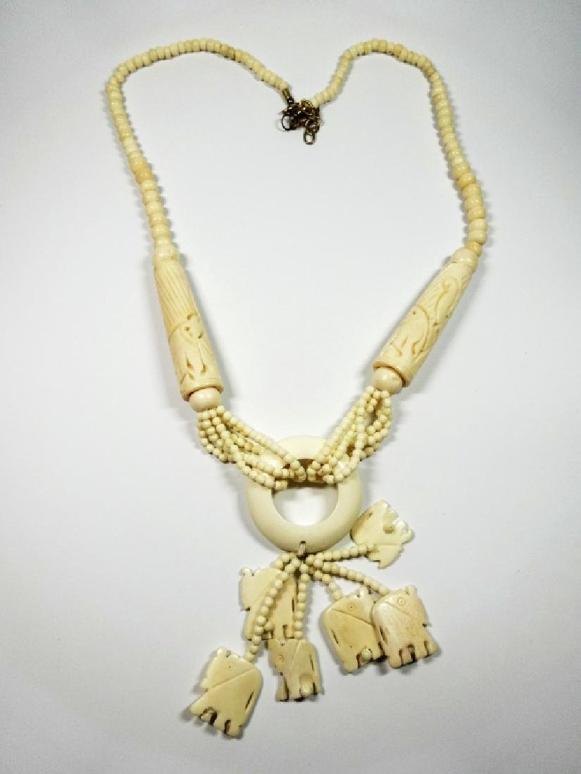 "CARVED BONE NECKLACE, ELEPHANTS, APPROX 34""L,"