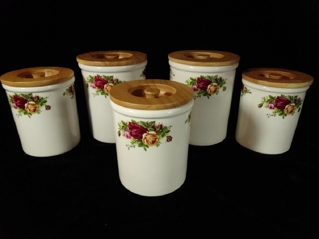 5 CLOVERLEAF ENGLAND POTTERY CANISTERS, WITH WOOD LIDS,