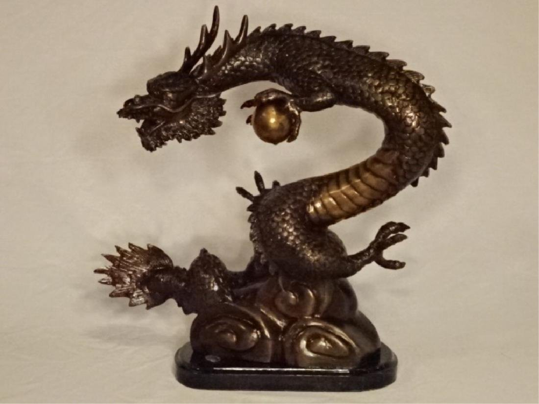 BRONZE SCULPTURE, CHINESE DRAGON CLUTCHING PEARL OF