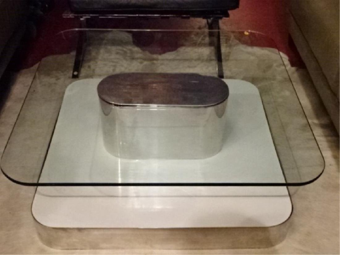 1970's GLASS AND POLISHED ALUMINUM COFFEE TABLE WITH