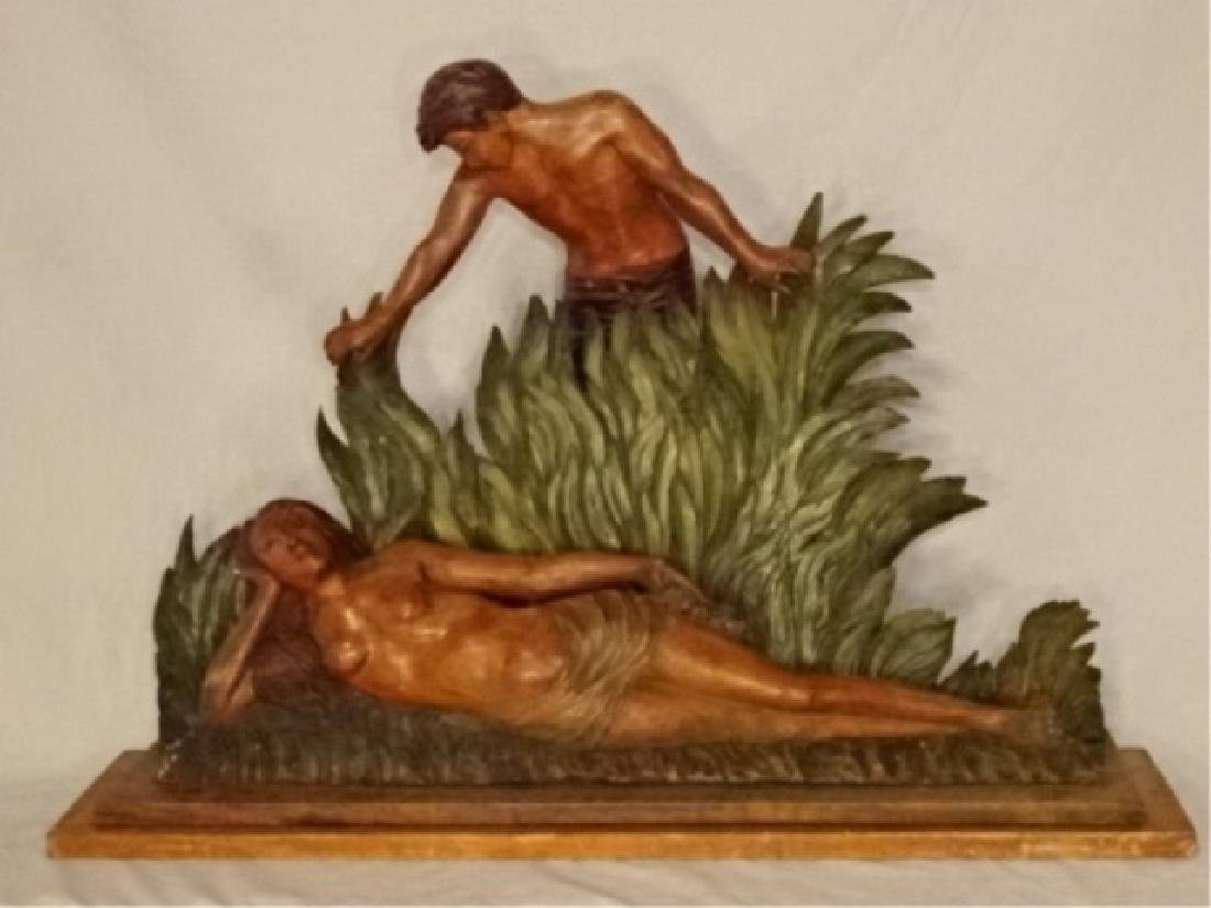 LARGE CARVED WOOD SCULPTURE, MAN AND WOMAN IN TROPICAL