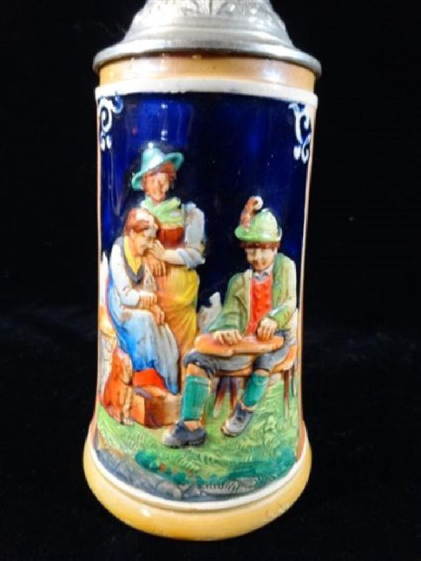 GERMAN PORCELAIN BEER STEIN, RELIEF DESIGN OF 3 FIGURES - 2