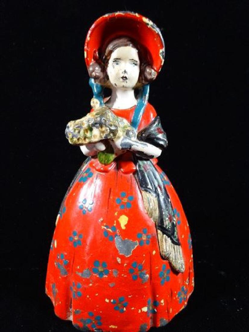 VINTAGE METAL WOMAN SCULPTURE IN RED BONNET, GOOD