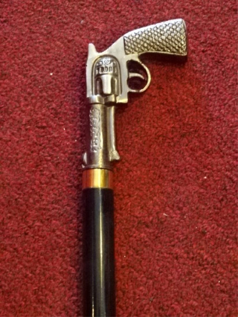 HANDGUN SHAPED SWORD CANE / WALKING STICK, METAL HANDLE