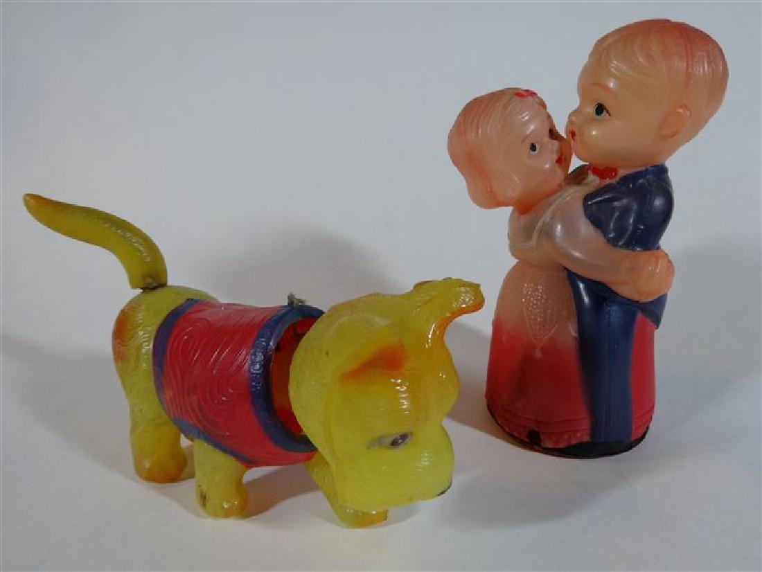 2 VINTAGE CELLULOID TOYS WITH WIND UP MOVEMENT, DOG AND