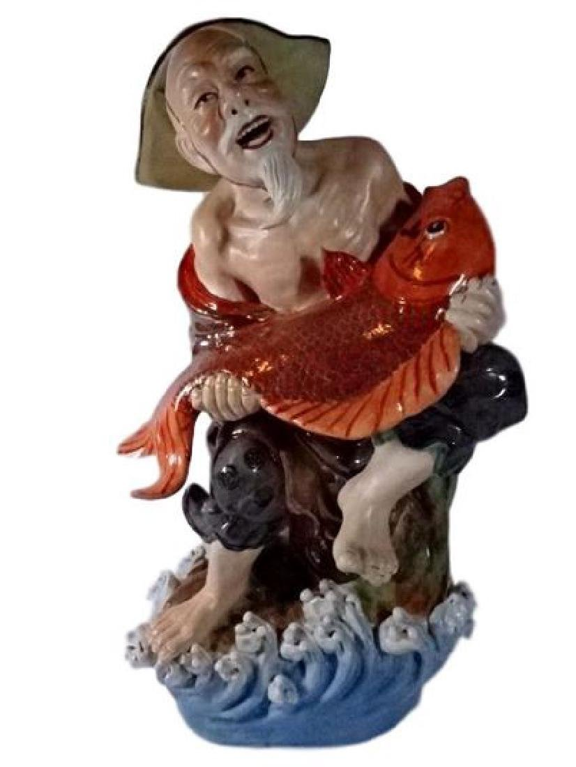 LARGE CHINESE PORCELAIN SCULPTURE, MAN WITH FISH, VERY