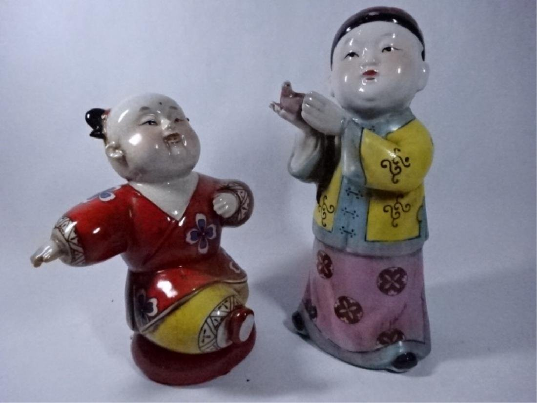 2 CHINESE PORCELAIN SCULPTURES, BOY WITH BIRD AND BOY
