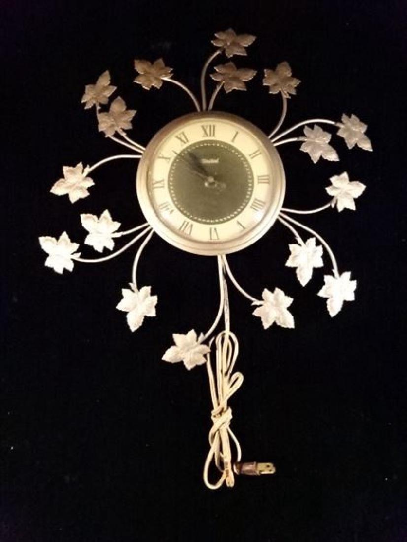 VINTAGE METAL UNIVERSAL WALL CLOCK, MAPLE LEAF DESIGN,