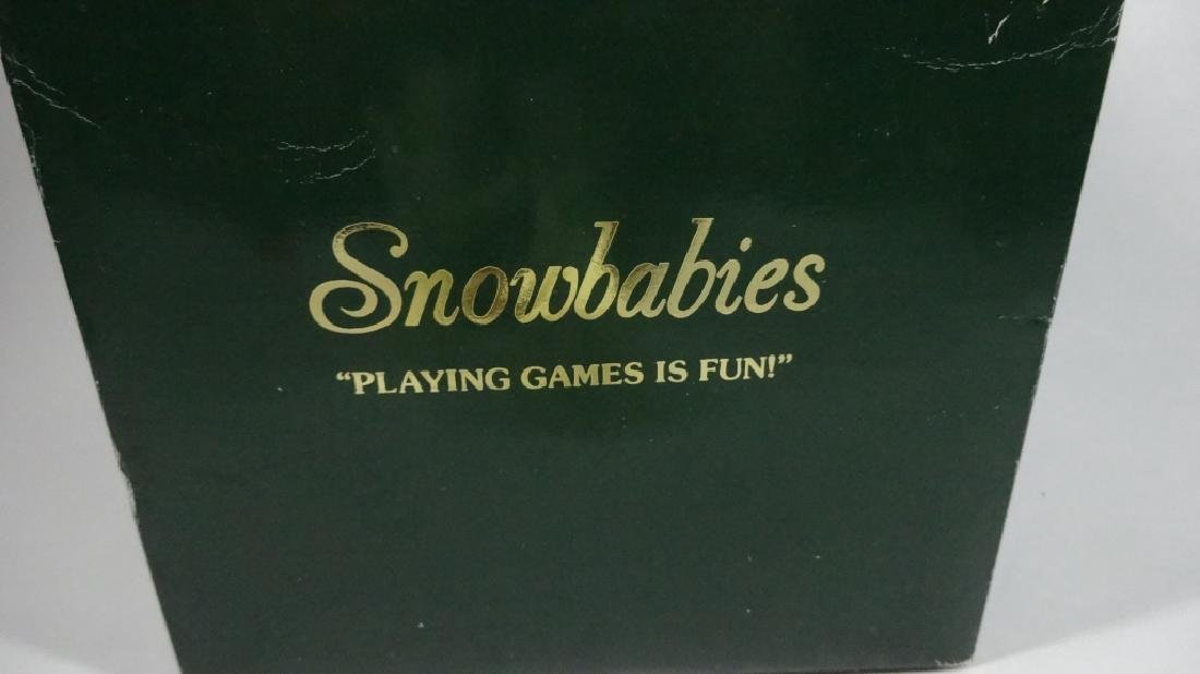 "SNOWBABIES BISQUE PORCELAIN FIGURINE, ""PLAYING GAMES IS - 6"