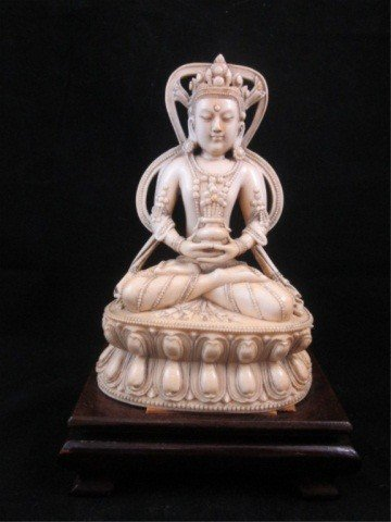 95: ANTIQUE IVORY FIGURINE OF A SEATED BUDDHA, FINELY C