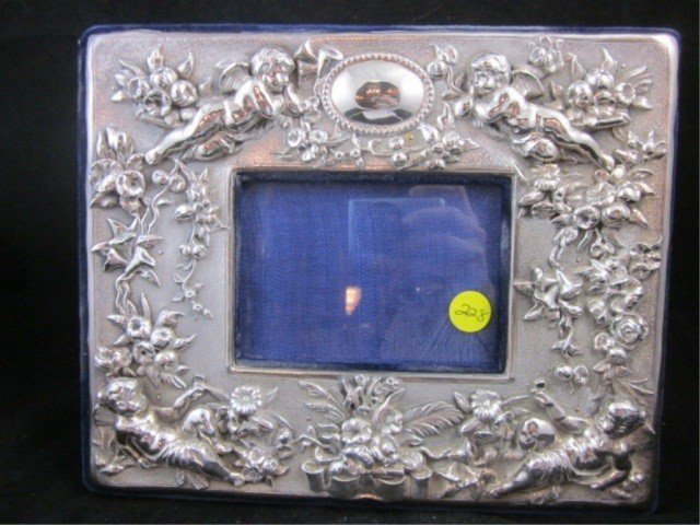 204: STERLING SILVER PICTURE FRAME, WITH ANGELS & FLORA