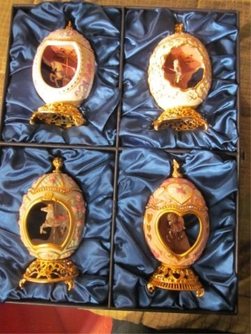 29: FOUR FABERGE EGG STYLE MUSIC BOXES WITH CAROUSEL HO