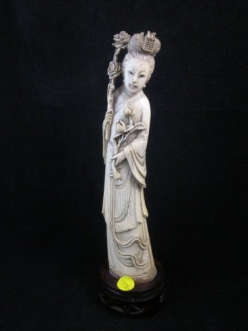 48: ANTIQUE CHINESE IVORY FIGURINE OF A BEAUTY HOLDING