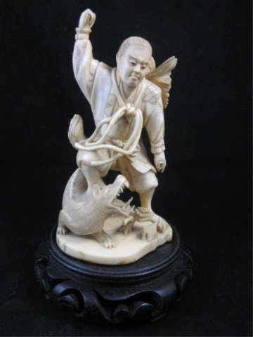 49: ANTIQUE IVORY FIGURINE OF A MAN WITH A DOG, FINELY