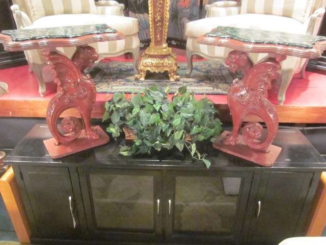 24: PAIR OF CARVED WOOD GRIFFIN MOTIF DEMI-LUNE TABLES
