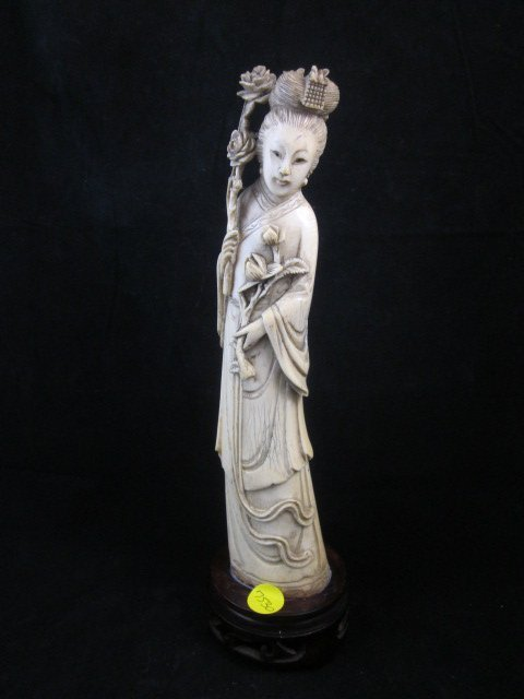 69: ANTIQUE CHINESE IVORY FIGURINE OF A BEAUTY HOLDING