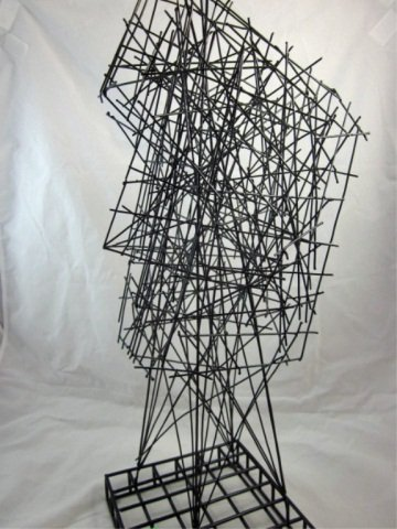 """167: ABSTRACT WIRE SCULPTURE OF A FACE, APPROX 22"""" HIGH - 6"""