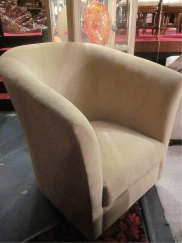 1A: OVERSCALE ARMCHAIR WITH SHELL BACK AND CURVED ARMS,