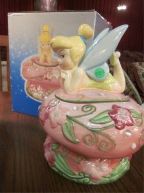 DISNEY EXCLUSIVE RECLINING TINKERBELL COOKIE JAR, A