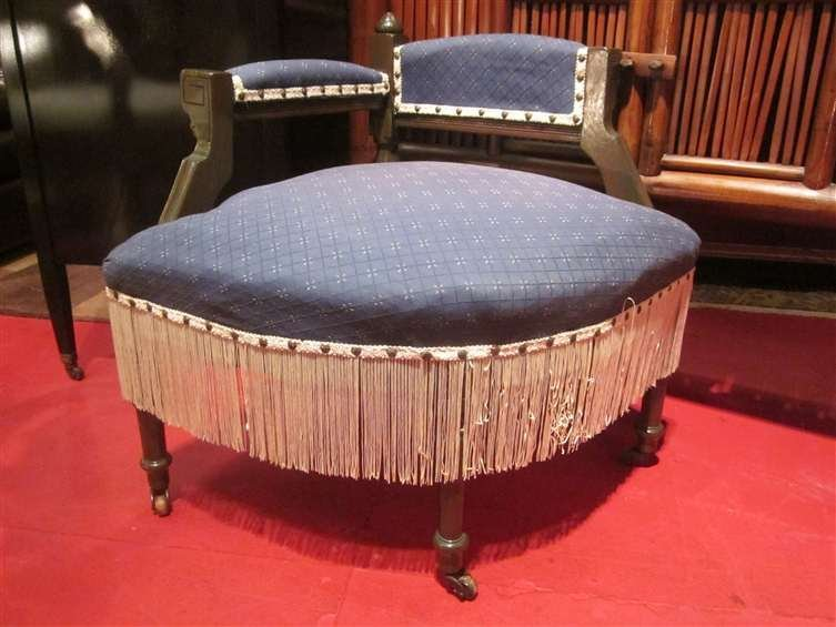 18: VINTAGE UPHOLSTERED BENCH WITH FRINGE, ON CASTERS