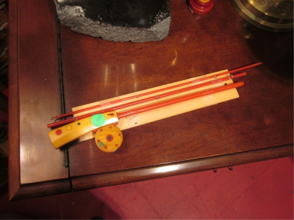 12: VINTAGE BAKELITE FISHING ROD, APPROX 3' LONG WHEN A