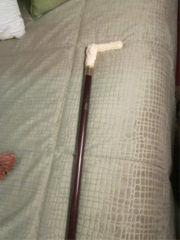 20: CANE WITH CARVED MARINE IVORY FIGURAL HANDLE
