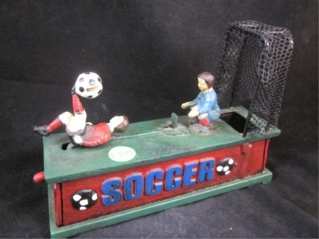 "23: CAST IRON BANK - SOCCER GAME, APPROX 7 3/4"" LONG &"