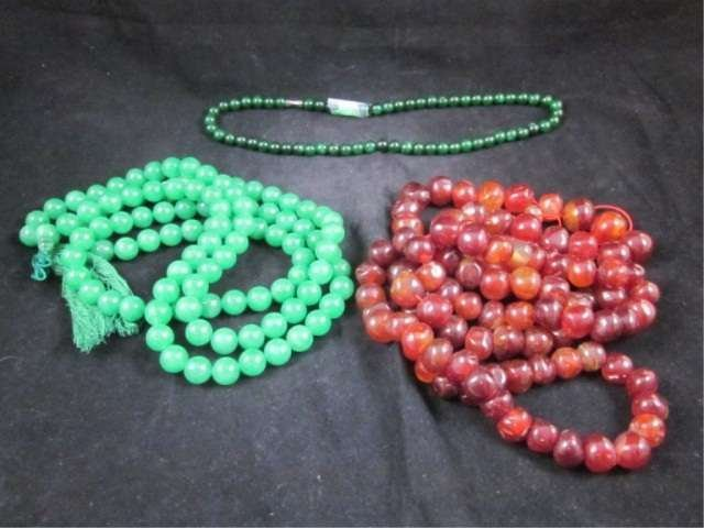 8: GROUP OF THREE NECKLACES - SPINACH JADE CHOKER APPRO