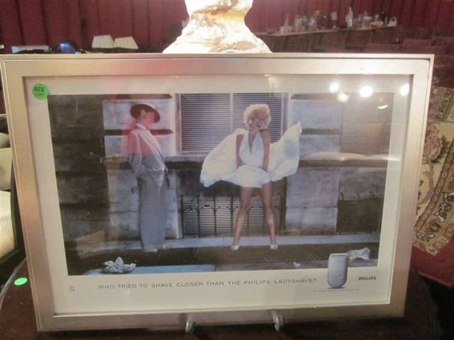 10: FRAMED ADVERTISING POSTER FEATURING MARILYN MONROE,