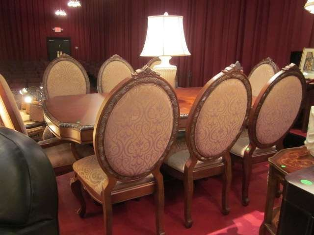 76: ORNATE DINING TABLE WITH 2 LEAVES AND 8 OVAL BACK C
