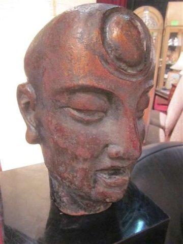 82: BRONZE SCULPTURE OF A BUDDHA HEAD, SHOWING THE THIR