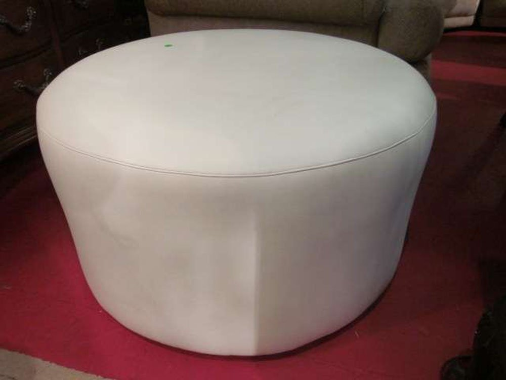 "24: LARGE ROUND WHITE LEATHER OTTOMAN, APPROX 30"" ROUND"