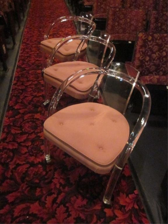 3: SET OF THREE LUCITE CHAIRS WITH CURVED BACKS, ON CAS
