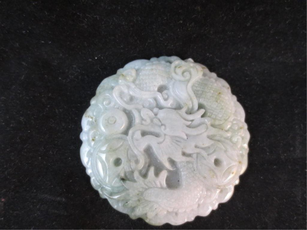 "21: CARVED LIGHT GREEN JADE DRAGON PENDANT, APPROX 2"" D"