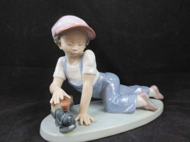 "176: RETIRED LLADRO PORCELAIN FIGURINE ""ALL ABOARD"", #7"