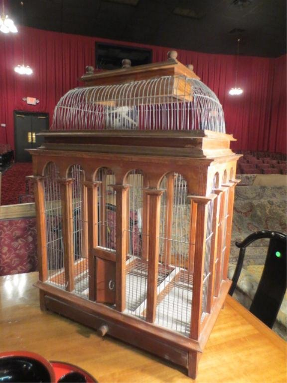 """9: LARGE ORNATE WOOD AND WIRE BIRDCAGE, APPROX 40"""" L"""