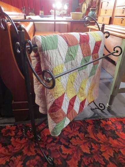 15: POTTERY BARN KING SIZE QUILT ON IRON QUILT STAND