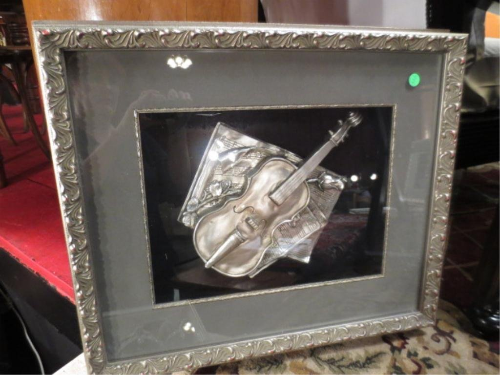9: PAIR OF SHADOWBOX FRAMED SILVER TONE BAS RELIEF MUSI