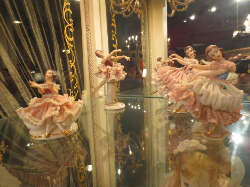 21: FOUR DRESDEN PORCELAIN LACE DANCING GIRLS, MADE IN