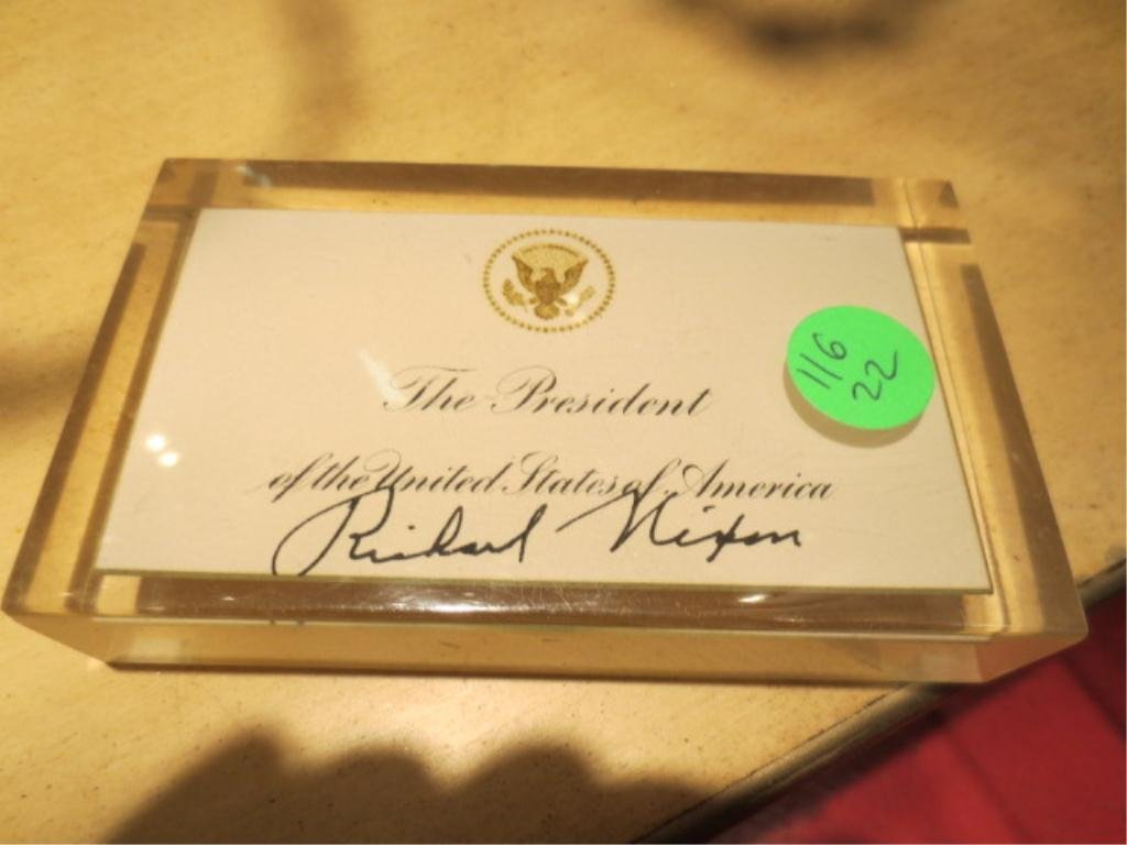 7: PRESIDENT RICHARD NIXON AUTOGRAPHED CARD, ENCASED IN