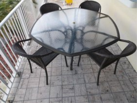 20: PATIO TABLE AND FOUR ARMCHAIRS BY EBEL OUTDOOR FURN