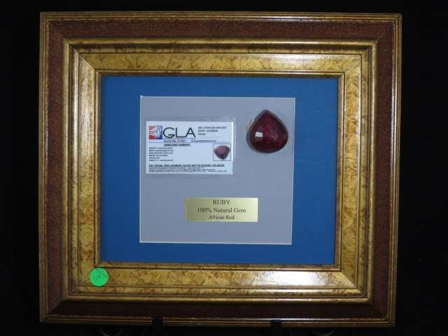 LARGE NATURAL RUBY, FRAMED AND MOUNTED, WITH GLA CERTIF