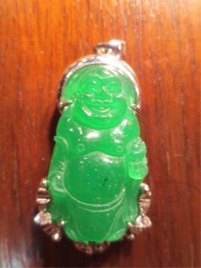 CARVED GREEN JADE BUDDHA IN STERLING SILVER SETTING , A