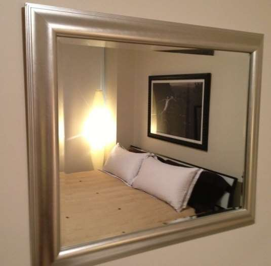 MODERN MIRROR IN A THICK SILVER FRAME WITH DECORATIVE R